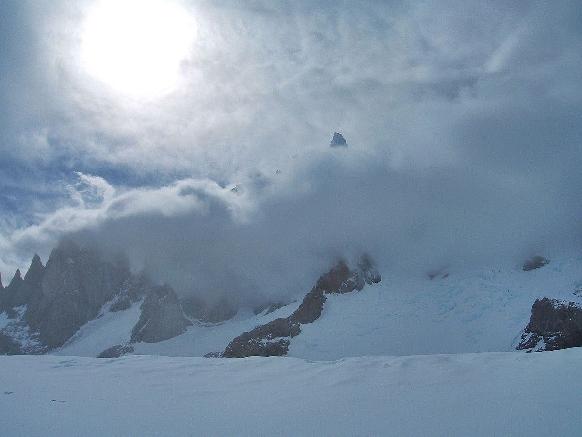 Cerro Torre peaking out of the cloud after a blizzard